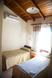 A bed or beds in a room at Complejo Vacacional Coovaeco