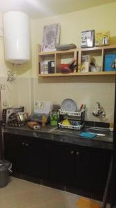 A kitchen or kitchenette at Zahed Apartment