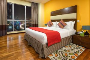 A bed or beds in a room at Ramada Downtown Dubai