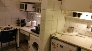 A kitchen or kitchenette at Apartment Patrícia with garden