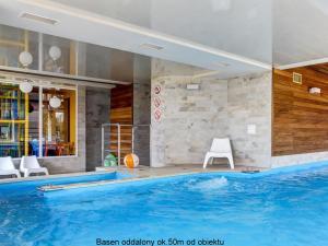 The swimming pool at or near Marina Jastarnia Bis