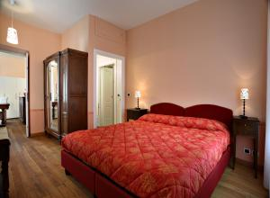 A bed or beds in a room at Villa D'Azeglio