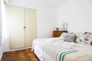 A bed or beds in a room at Departamento Maria Paula
