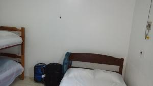 A bed or beds in a room at Residencial Dom Luiz