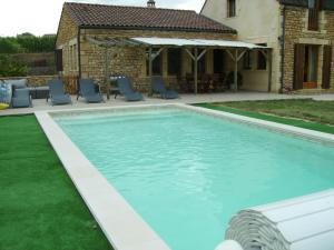 The swimming pool at or near Maison Le Claud de Séchebelle