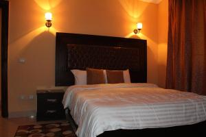 Krevet ili kreveti u jedinici u objektu Heliopolis Rock Residence