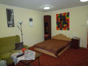 A bed or beds in a room at Örs vezér Apartment Beatle
