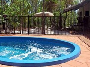 The swimming pool at or near Wagait Beach Bush Retreat