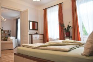 A bed or beds in a room at Business Home Vienna