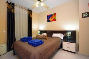 A bed or beds in a room at Apartamentos City Beach Lluch