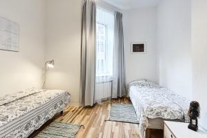 Gulta vai gultas numurā naktsmītnē Apartments in Riga