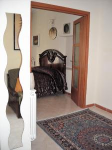 A bed or beds in a room at Appartamento Pietro Giuliano