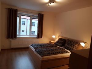 Postel nebo postele na pokoji v ubytování Apartments Anna and Ondra