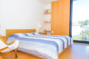 A bed or beds in a room at Liiiving In Caminha | Lawny Pool House