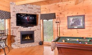 A pool table at Almost Heaven Four-Bedroom Cabin