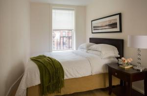 A bed or beds in a room at Oakwood at 234 Newbury