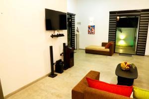 A television and/or entertainment center at Coco Beach Villa