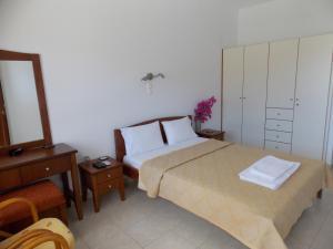 Letto o letti in una camera di Kato Zakros Palace Apartments