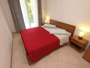 A bed or beds in a room at Apartments Romano 1099