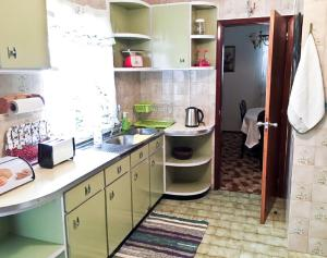 A kitchen or kitchenette at Traditional House - Caminho do Ilhéu