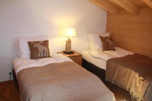A bed or beds in a room at Chalet Grand Roi