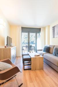 A seating area at Pierre & Vacances Andorra Sunari Peretol