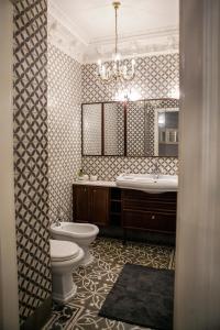 A bathroom at Royal Residence by OTR