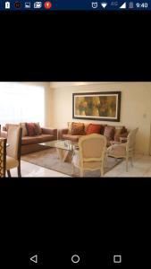 A seating area at San Martin Apartment Miraflores