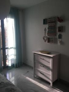 A bed or beds in a room at Hipalis Palmera