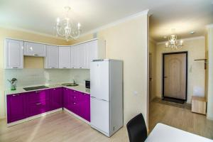A kitchen or kitchenette at Apartments Promenade Expo