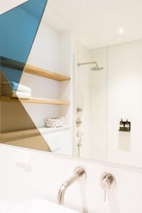 A bathroom at Kith & Kin Boutique Apartments