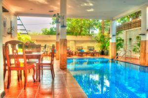 The swimming pool at or near Shadow Angkor Villa