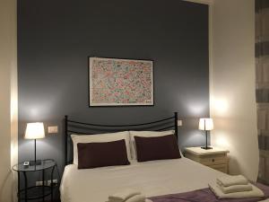 Un ou plusieurs lits dans un hébergement de l'établissement Residenza San Martino