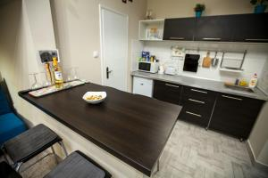 A kitchen or kitchenette at Little Heart Apartman