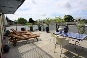 En balkon eller terrasse på Le Bouscat Hermes