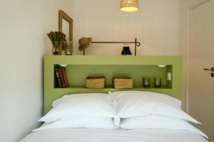 A bed or beds in a room at The Green House