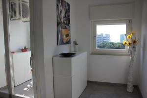 A kitchen or kitchenette at Rosato Sea View Apartment