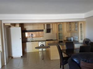 Virtuvė arba virtuvėlė apgyvendinimo įstaigoje A charming hill side apartment