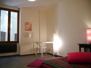 Un ou plusieurs lits dans un hébergement de l'établissement Le lilas