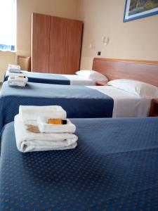 A bed or beds in a room at Hotel Residence Degra