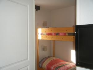 A bunk bed or bunk beds in a room at L'Eterlou