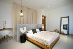 A bed or beds in a room at Canggu Beach Apartments