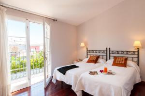A bed or beds in a room at Meloneras Hills 16 With Pool
