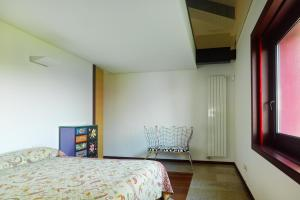 A bed or beds in a room at Cangas Village Grupo de Villas