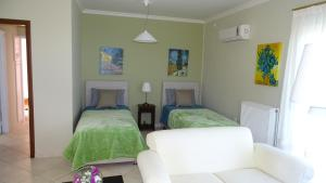 A bed or beds in a room at Bella Vista - Panoramic View