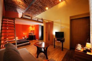 Televizorius ir (arba) pramogų centras apgyvendinimo įstaigoje Siesta Aparthotel