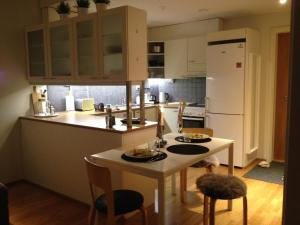 A kitchen or kitchenette at Arctic Boulevard Home 2