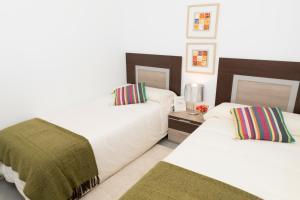 A bed or beds in a room at Mar de Pulpi Las Azucenas Mar Holidays