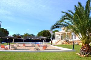 The swimming pool at or near Villa Carvoeiro by GalanteVasques