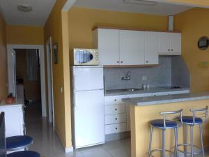 A kitchen or kitchenette at Apartment Barbados A